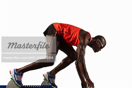 Runner crouched at starting line Stock Photo - Premium Royalty-Free, Image code: 649-04827206