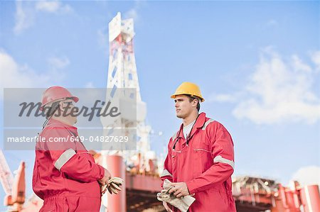 Workers talking on oil rig Stock Photo - Premium Royalty-Free, Image code: 649-04827629