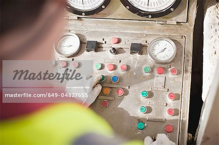 Worker at control panel of oil rig Stock Photo - Premium Royalty-Free, Image code: 649-04827655