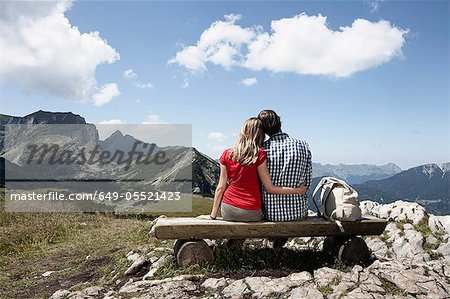 Couple sitting on bench on hilltop Stock Photo - Premium Royalty-Free, Image code: 649-05521423