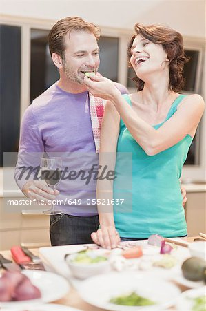 Couple eating and cooking dinner Stock Photo - Premium Royalty-Free, Image code: 649-05521637