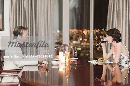 Couple having romantic dinner at home Stock Photo - Premium Royalty-Free, Image code: 649-05521643
