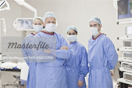 Team of doctors in operating room Stock Photo - Premium Royalty-Free, Image code: 649-05521759