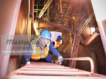 Engineer climbing staircase in ship Stock Photo - Premium Royalty-Free, Image code: 649-05522193