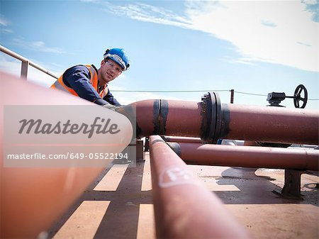 Engineer inspecting ship parts Stock Photo - Premium Royalty-Free, Image code: 649-05522194