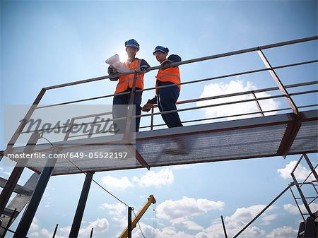 Engineers overlooking ship building Stock Photo - Premium Royalty-Free, Image code: 649-05522197