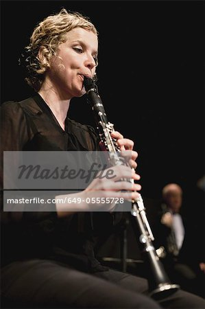 Clarinet player in orchestra Stock Photo - Premium Royalty-Free, Image code: 649-05555728