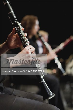 Clarinet player in orchestra Stock Photo - Premium Royalty-Free, Image code: 649-05555729