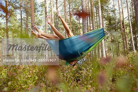 Women relaxing in hammock in forest Stock Photo - Premium Royalty-Free, Image code: 649-05555907