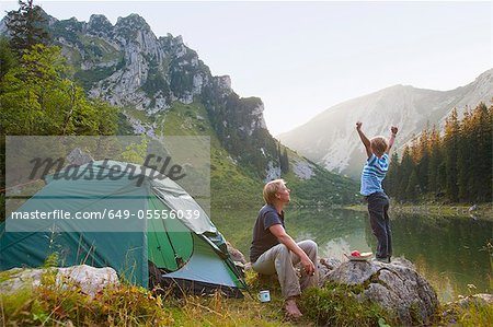 Father and son relaxing at campsite Stock Photo - Premium Royalty-Free, Image code: 649-05556039
