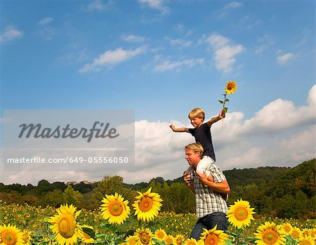 Father and son in field of flowers Stock Photo - Premium Royalty-Free, Image code: 649-05556050