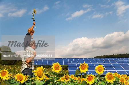 Father and son in field by solar panels Stock Photo - Premium Royalty-Free, Image code: 649-05556051