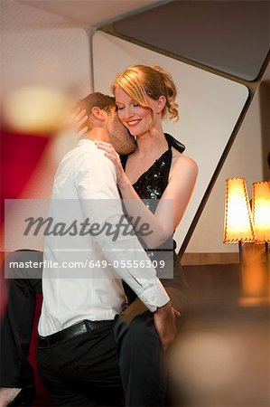 Smiling couple dancing in bar Stock Photo - Premium Royalty-Free, Image code: 649-05556309