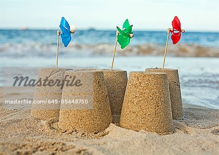 Sandcastles with pinwheels on beach Stock Photo - Premium Royalty-Free, Image code: 649-05648750