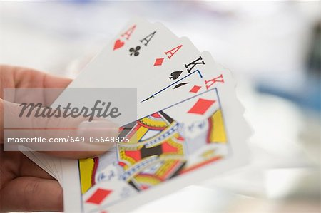 Close up of woman playing cards Stock Photo - Premium Royalty-Free, Image code: 649-05648825