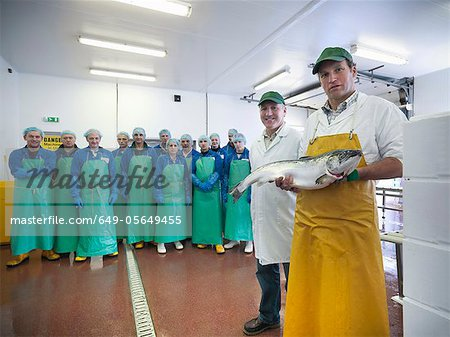 Workers in fish processing plant Stock Photo - Premium Royalty-Free, Image code: 649-05649455