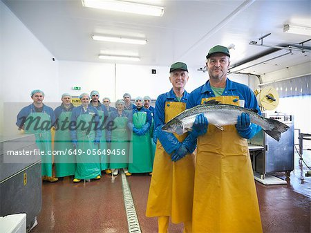 Workers in fish processing plant Stock Photo - Premium Royalty-Free, Image code: 649-05649456