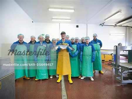 Workers in fish processing plant Stock Photo - Premium Royalty-Free, Image code: 649-05649457