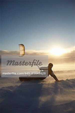 Man windsurfing on snowboard Stock Photo - Premium Royalty-Free, Image code: 649-05649629