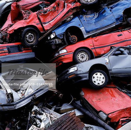 Wrecked cars in pile at junkyard Stock Photo - Premium Royalty-Free, Image code: 649-05649785