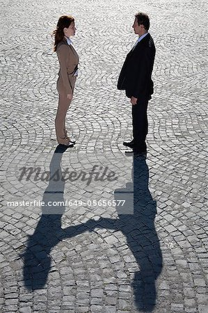 Shadows shaking hands outdoors Stock Photo - Premium Royalty-Free, Image code: 649-05656577