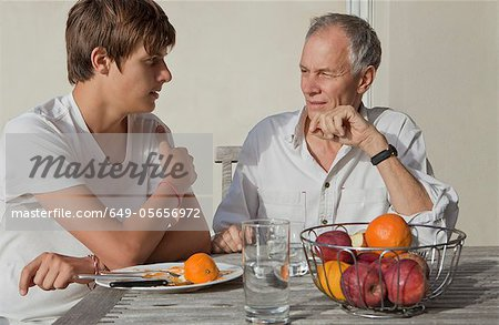 Father and son eating fruit outdoors Stock Photo - Premium Royalty-Free, Image code: 649-05656972
