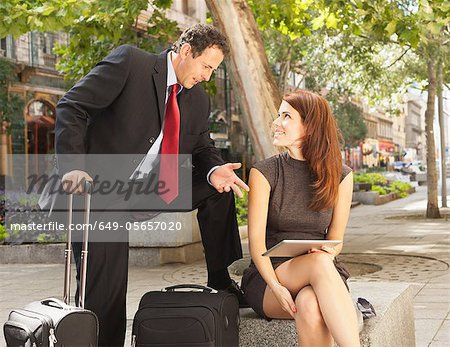 Business people talking outdoors Stock Photo - Premium Royalty-Free, Image code: 649-05657020