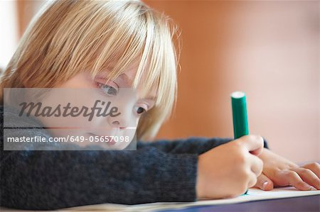 Close up of boy drawing indoors Stock Photo - Premium Royalty-Free, Image code: 649-05657098