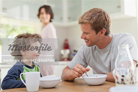Family eating breakfast in kitchen Stock Photo - Premium Royalty-Free, Image code: 649-05657165
