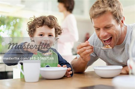 Father and son eating breakfast Stock Photo - Premium Royalty-Free, Image code: 649-05657166