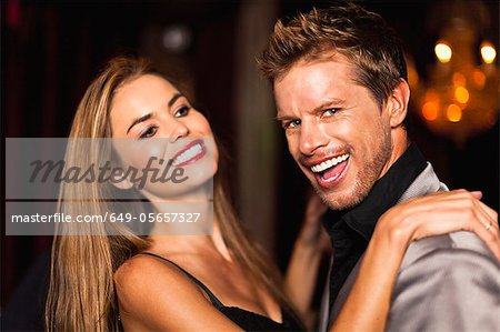 Smiling couple dancing in club Stock Photo - Premium Royalty-Free, Image code: 649-05657327