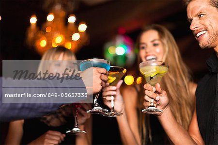 Smiling people having cocktails in club Stock Photo - Premium Royalty-Free, Image code: 649-05657333