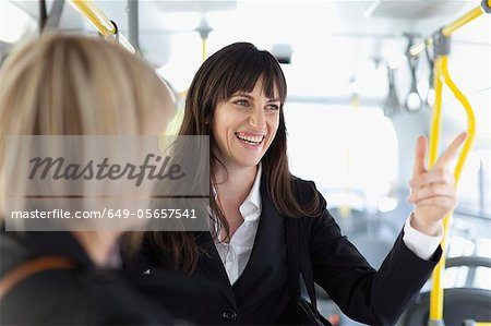 Smiling businesswomen riding the bus Stock Photo - Premium Royalty-Free, Image code: 649-05657541