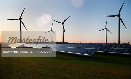 Wind turbines and solar panels in field Stock Photo - Premium Royalty-Free, Image code: 649-05657730