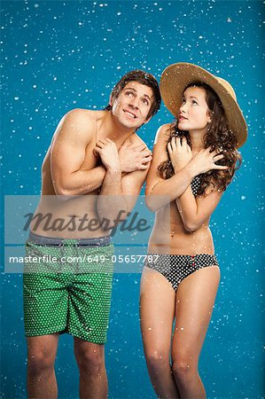 Couple in swimsuits shivering in snow Stock Photo - Premium Royalty-Free, Image code: 649-05657787