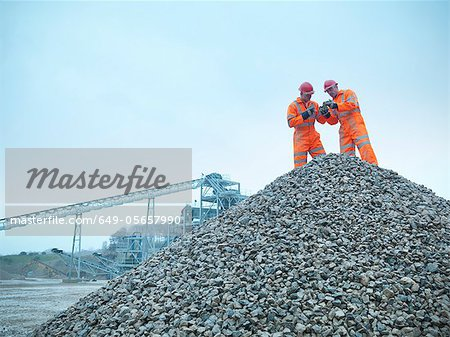 Workers inspecting quarry rocks Stock Photo - Premium Royalty-Free, Image code: 649-05657990