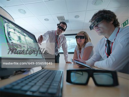 Scientists wearing 3D glasses in lab Stock Photo - Premium Royalty-Free, Image code: 649-05658045