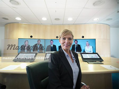Business people having video conference Stock Photo - Premium Royalty-Free, Image code: 649-05658053