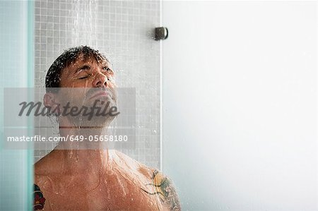 Man washing his hair in shower Stock Photo - Premium Royalty-Free, Image code: 649-05658180