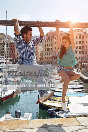 Couple playing on urban pier Stock Photo - Premium Royalty-Free, Image code: 649-05658438