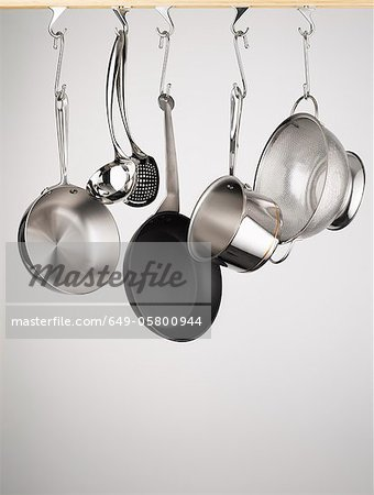 Pots and pans hanging from hooks Stock Photo - Premium Royalty-Free, Image code: 649-05800944