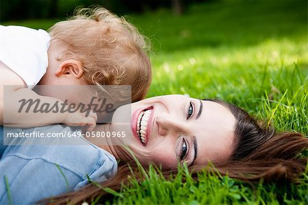 Mother holding toddler in park Stock Photo - Premium Royalty-Free, Image code: 649-05800965