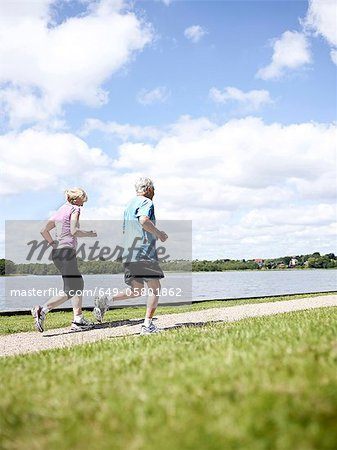 Older couple jogging together outdoors Stock Photo - Premium Royalty-Free, Image code: 649-05801862
