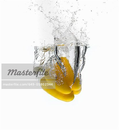 Bell pepper splashing in water Stock Photo - Premium Royalty-Free, Image code: 649-05802344