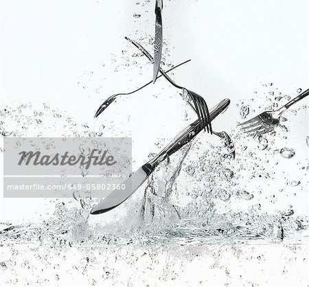 Silverware splashing in water Stock Photo - Premium Royalty-Free, Image code: 649-05802360