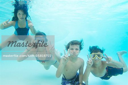 Smiling children playing in pool Stock Photo - Premium Royalty-Free, Image code: 649-05819751