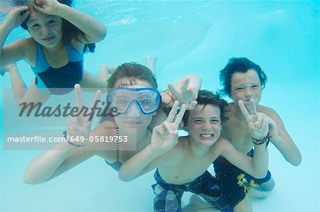 Smiling children playing in pool Stock Photo - Premium Royalty-Free, Image code: 649-05819753