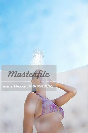 Woman in bikini showering outdoors Stock Photo - Premium Royalty-Free, Image code: 649-05819761