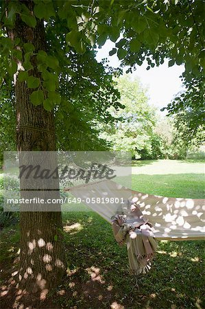 Blanket in backyard hammock Stock Photo - Premium Royalty-Free, Image code: 649-05819801