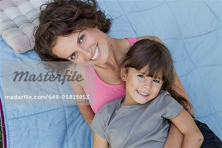 Mother and daughter relaxing on blanket Stock Photo - Premium Royalty-Free, Image code: 649-05819853
